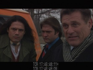 The detectives and their snitch confront some dealers in the park about the death.